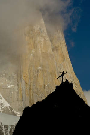 rockclimber balancing on cliffs facing the massive red granite wall of fitz roy peak, los glaciares national park, patagonia, argentina Stock Photo - 11698876