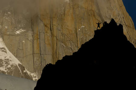 rockclimber on cliffs facing the massive red granite wall of fitz roy peak, los glaciares national park, patagonia, argentina Stock Photo - 11698866
