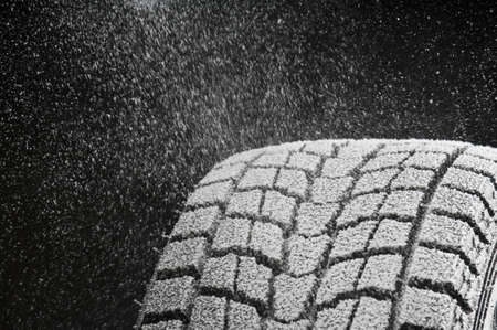 winter road: studio close-up detail of winter tire tread full of snow Stock Photo
