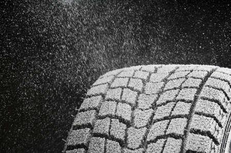 studio close-up detail of winter tire tread full of snow Standard-Bild