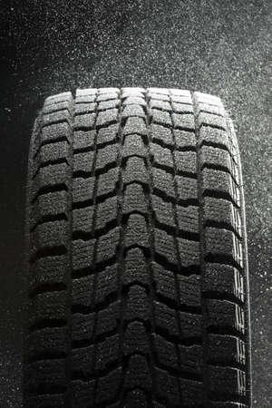 one winter tire  in  snow flakes Standard-Bild