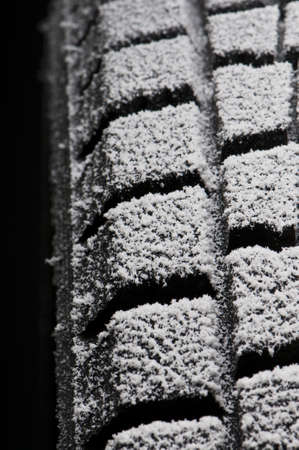 studio close-up detail of winter tire tread full of snow Stock Photo