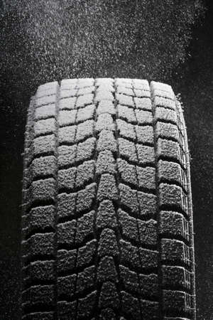 new and improved: one snowed winter tire Stock Photo