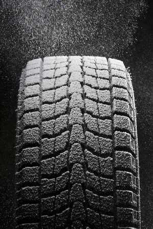 shorter: one snowed winter tire Stock Photo