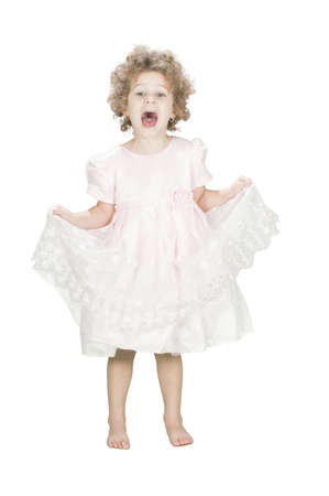 joyful bare feet toddler wearing a dress  isolated on white