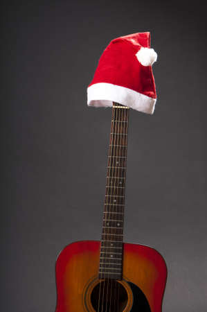 acoustical: classic accoustic guitar with santa claus cap  Stock Photo