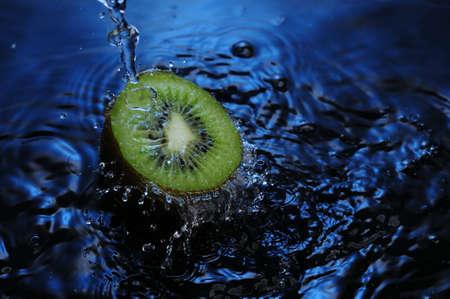 to watersplash: watersplash on green sliced kiwi fruit