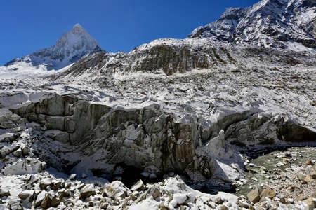 shivling: Gomukh (Gaumukh) origin of the Ganges river is Gangotri glacier snout with mount Shivling view, Garhwal Himalaya, Uttaranchal (Uttarakhand), India Stock Photo