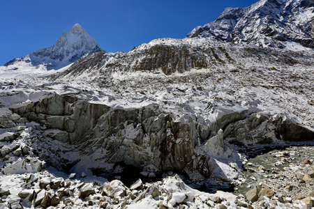 Gomukh (Gaumukh) origin of the Ganges river is Gangotri glacier snout with mount Shivling view, Garhwal Himalaya, Uttaranchal (Uttarakhand), India Standard-Bild