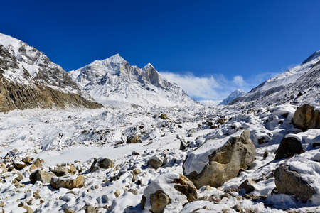 ganges: Gangotri glacier with Bhagirathi peaks in Garhwal Himalaya, Uttaranchal, Uttarakhand, India Stock Photo