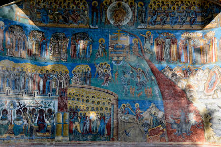 judgement day: detail of Judgment Day Apocalypse fresco on Voronet monastery, Romania