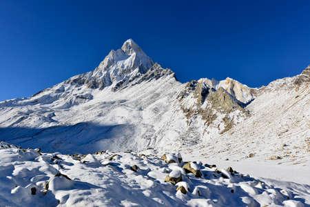shivling: dramatic Mount Shivling in the western Garhwal Himalaya, Uttarakhand, Uttaranchal, India Stock Photo