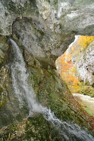 underground water gushing out of mountain wall at Ramet gorges, Trascau mountains, Transylvania, Romania