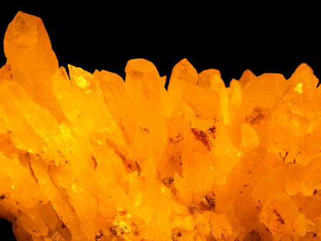 crystallization: golden crystals isolated on black background