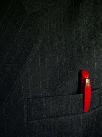 Red pen in the pocket of a businessman Standard-Bild