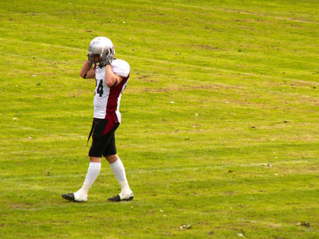 American football player leaving the sport field