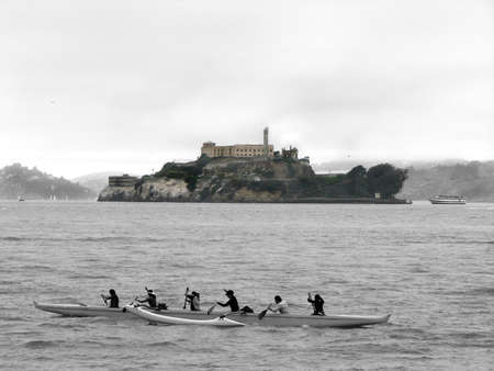 Alcatraz Island with a  kayak in front of it, view from Pier 39 photo