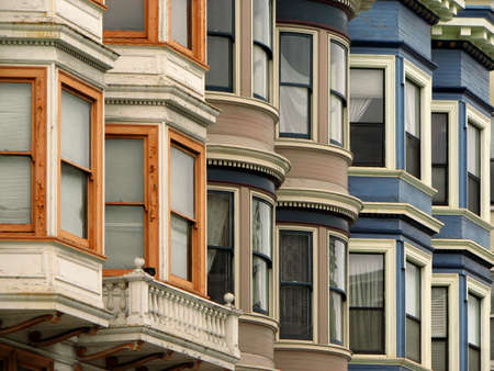 row house: Windows from colorful Victorian Houses in San Francisco, California, USA