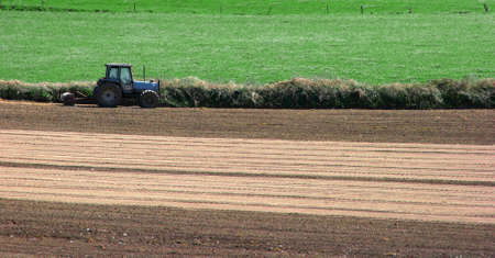 Tractor at work out on field, ploughing photo