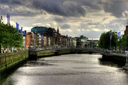 Hapenny bridge on River Liffey in Dublin city, Ireland, HDR image photo