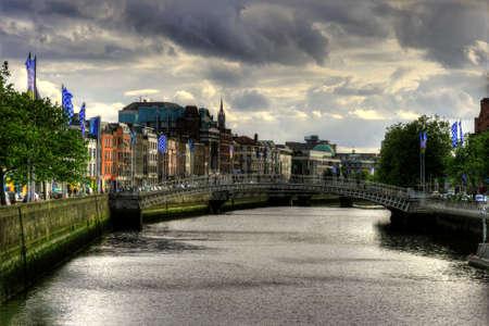 liffey: Hapenny bridge on River Liffey in Dublin city, Ireland, HDR image Stock Photo