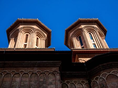 Two towers of a historic church in Bucharest. Architectural detail of a church.