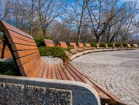 Benches in the park placed in the shape of a semicircle.