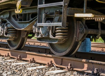 Close up with train wheels on track. Wheels of a train on the railway tracks.