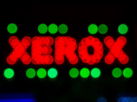 Bucharest/Romania - 05.16.2020: Word xerox written with bokeh red lights framed with green lights. Редакционное