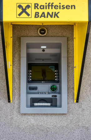 Bucharest/Romania - 05.16.2020: Detail with Raiffeisen bank ATM or cash machine in Bucharest. Editorial