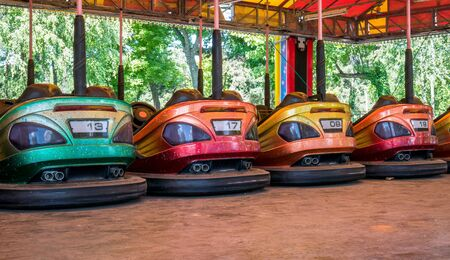 Colored electric bumper cars or dodgem cars parked.