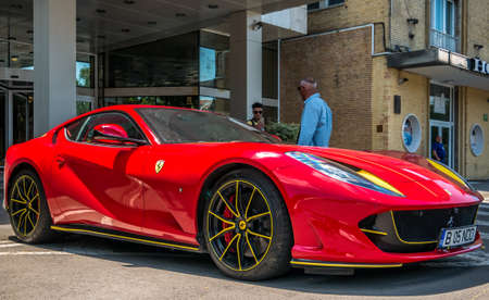 Brasov/Romania - 06.28.2020: A red Ferrari 812 Superfast parke in front of Aro Palace Hotel.