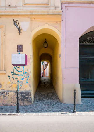 Brasov/Romania - 06.28.2020: Rope street (strada sforii) located in Brasov is one of the narrowest streets in Europe. Editorial