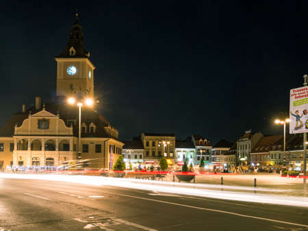 Brasov/Romania - 06.28.2020: Brasov city hall building located in the old town Council Square. Brasov's main square long exposure night photo.