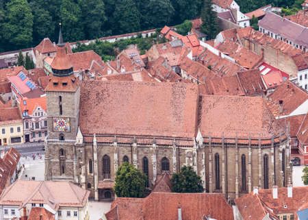 Brasov/Romania - 06.28.2020: Aerial view with The black church (Biserica Neagra) located in the center of Brasov. Famous tourist attraction.