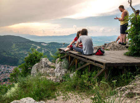 Brasov/Romanai -06.28.2020: Belvedere point on Mount Tampa. People enjoying a beautiful sunset over Brasov city.