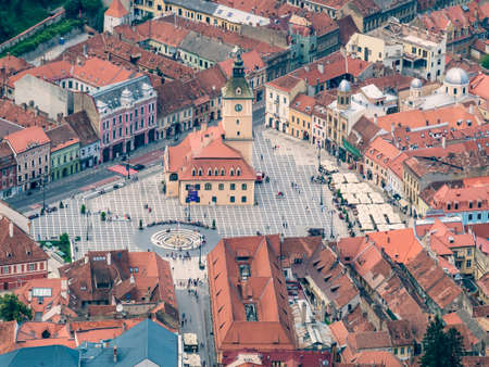 Brasov/Romania - 06.28.2020: Aerial view of the city hall building located in the old town Council Square of Brasov..