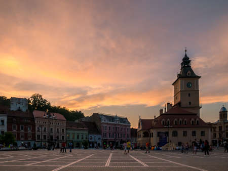 Brasov/Romania - 06.28.2020: Brasov city hall building located in the old town Council Square. Brasov's main square at sunset.