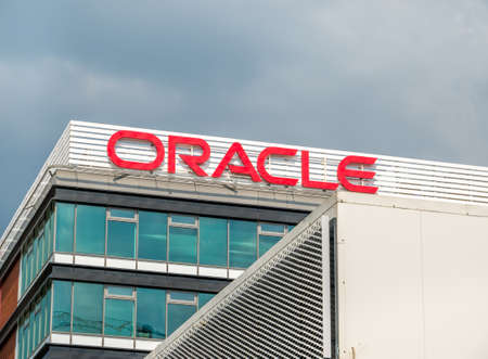 Bucharest/Romania - 07.18.2020: Oracle headquarter building in Bucharest. Logo of the Oracle company on a office building.