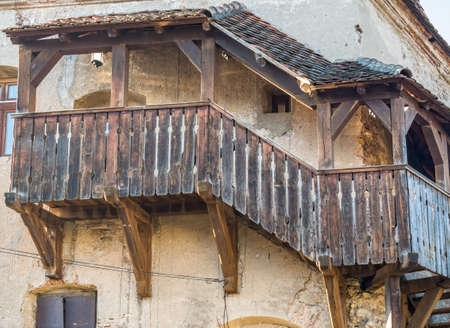 Detail with a medieval wooden covered staircase in Sighisoara, Romania.