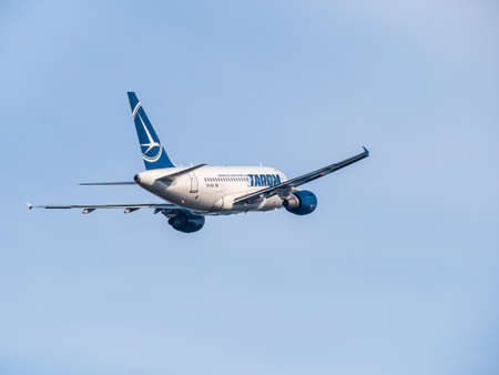 Otopeni, Romania - 01.23.2021 - Tarom Airbus A318-111 (YR-ASA) airplane flying against blue sky.