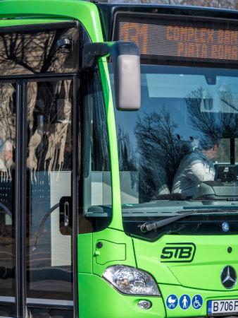 Bucharest, Romania - 02.22.2020: New Mercedes buses belonging to Bucharest Transit Corporation( Societatea de Transport Bucuresti -STB) in traffic.