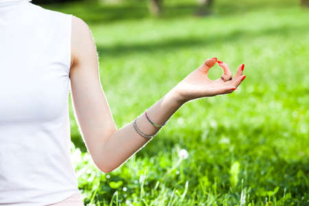 gyan: young caucasian woman hand in Gyan mudra yoga position symbolizes mental peace