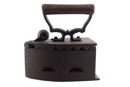 scorch: an isolated antique coal laundry iron from Transilvania