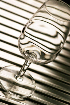 empty glass on iron basin sepia tone