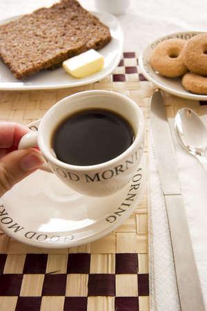 woman having a coffee at breakfast