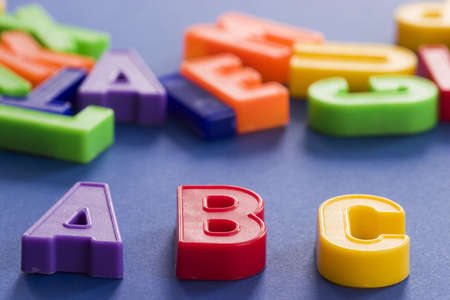 plastic colored letters with some letters out of focus in the background Stock Photo - 255614