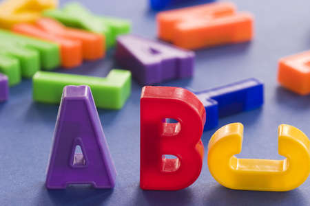 plastic colored letters with some out of focus in the background Stock Photo - 255612