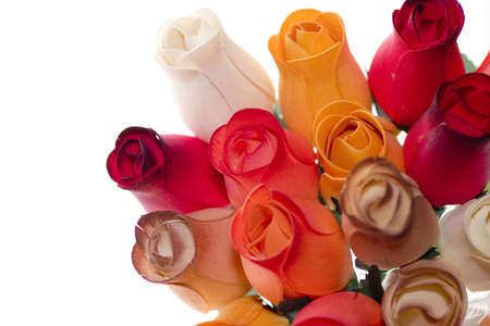 a bouquet of colored wooden roses