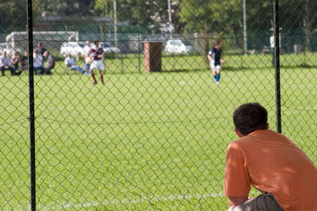 a father assisting to his son football match